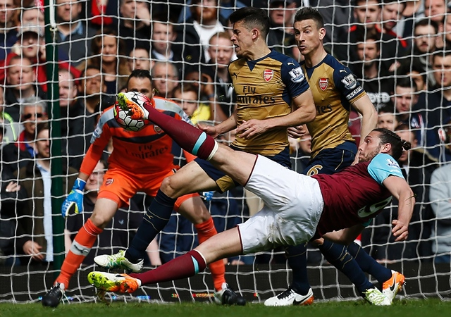 andy carroll shoots to score his team 039 s second goal against arsenal at the boleyn ground in upton park london on april 9 2016 photo afp