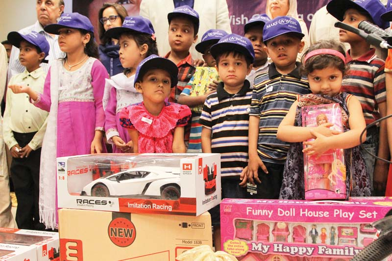 twenty five children suffering from different life threatening diseases were given gifts at a ceremony organised by make a wish foundation on saturday photo aysha saleem express