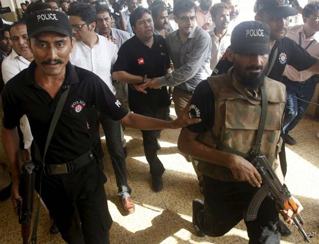 shoaib ahmed shaikh center the chief executive of axact was escorted from a court appearance last may photo reuters