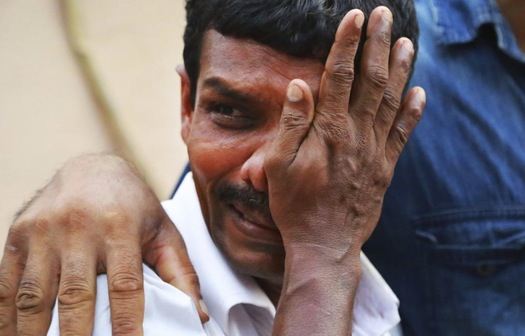 desperate search for loved ones in india temple blast