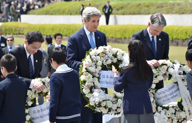 us secretary of state john kerry c japan 039 s foreign minister fumio kishida r and british foreign secretary philip hammond receive wreaths to offer at the memorial cenotaph for the 1945 atomic bombing victims in the peace memorial park on the sidelines of the g7 foreign ministers 039 meeting in hiroshima on april 11 2016 photo afp