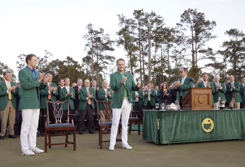 willett c celebrates after being presented with the green jacket which goes to the winner of the masters by defending champion spieth l photo afp