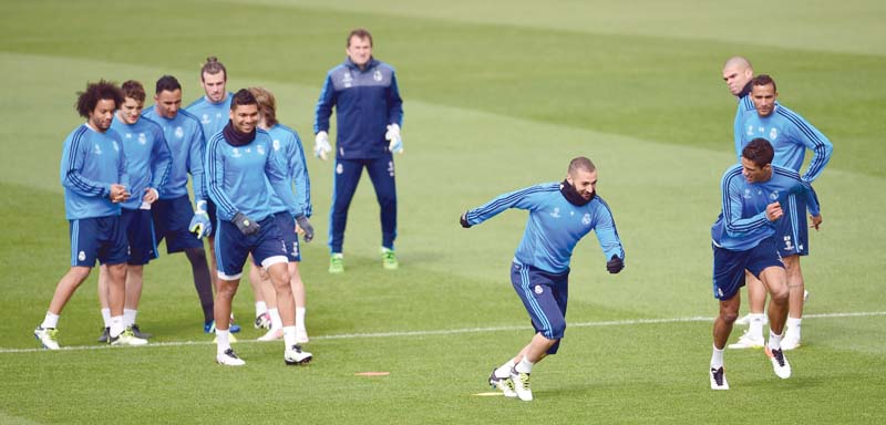 real players train on the eve of their champions league second leg against wolfsburg where they must overcome a two goal deficit to progress to the semi finals photo afp