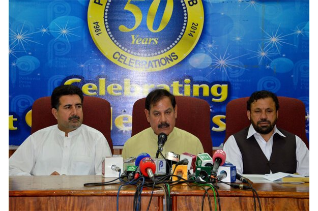 special assistant to cm on information mushtaq ahmed ghani addressing a news conference at peshawar press club photo ppi