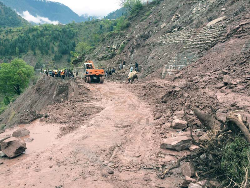 road workers use excavators to clear debris from landslides in balakot after sunday s massive earthquake photo express