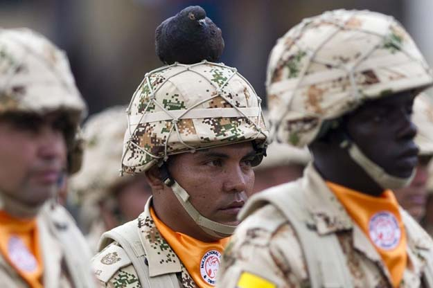 colombian infantry soldiers to be deployed as the multinational force and observers peacekeeping force in the sinai peninsula take part in a military ceremony at bolivar square in bogota colombia on april 03 2013 photo afp