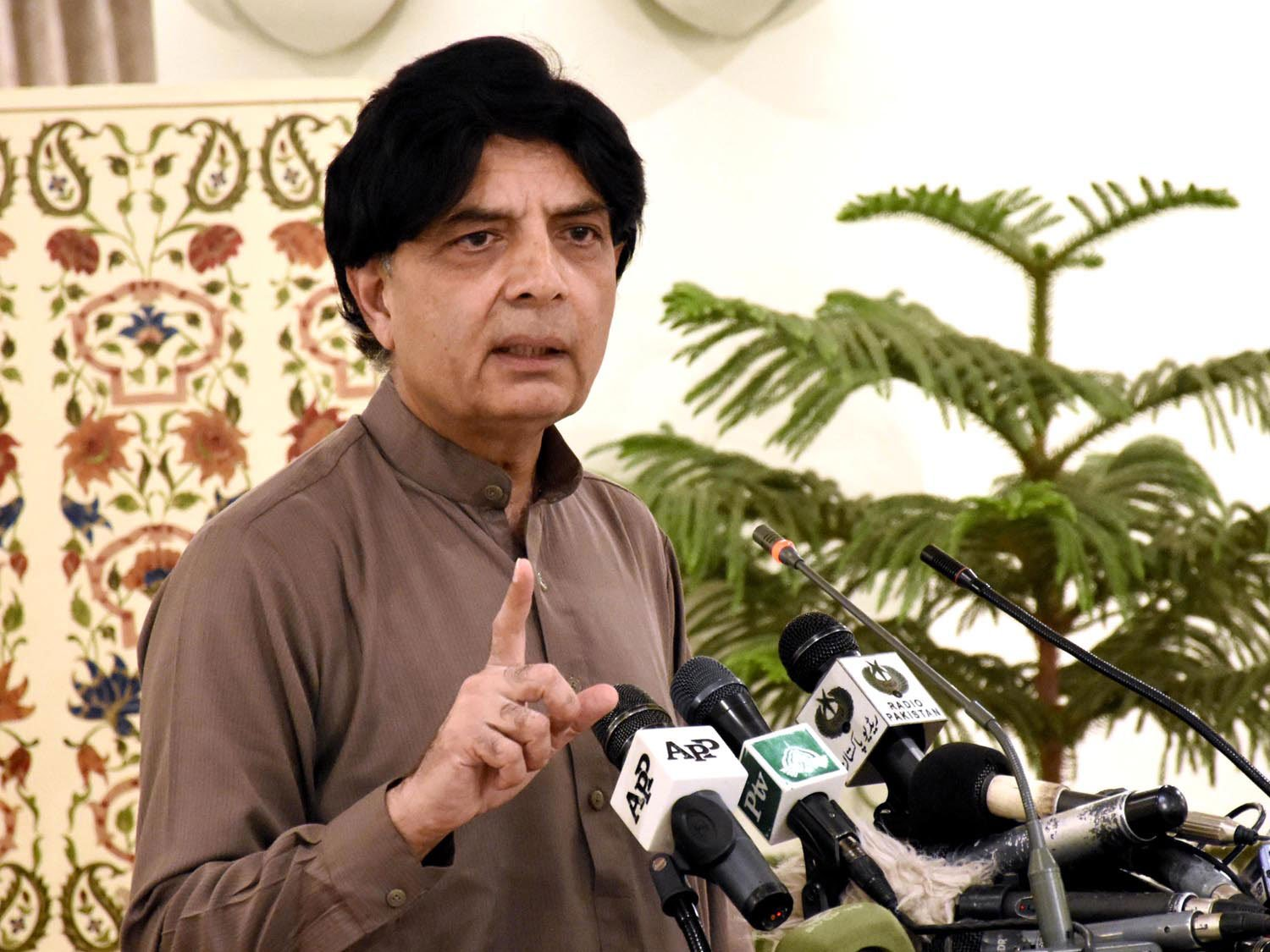 interior minister addressing a press conference in islamabad on april 11 2016 photo pid