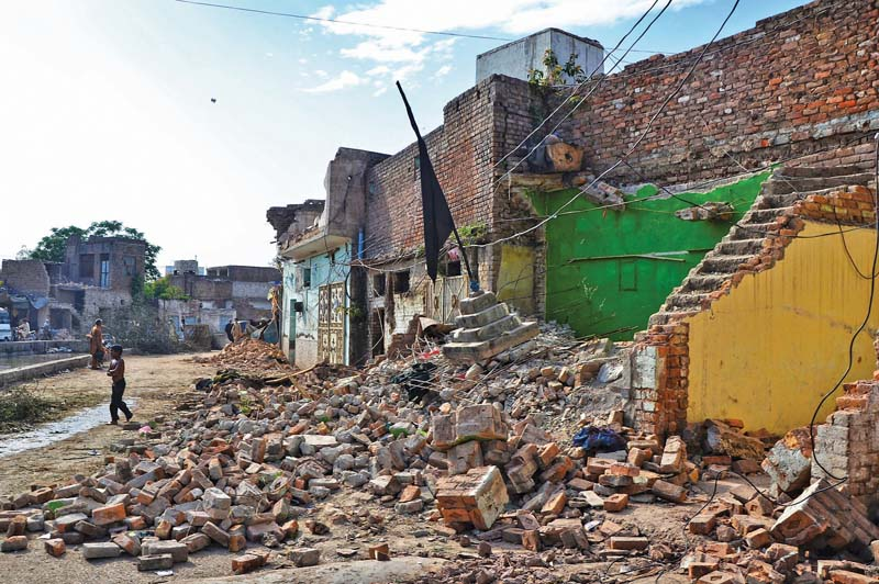 demolished structures in imamia colony photo express