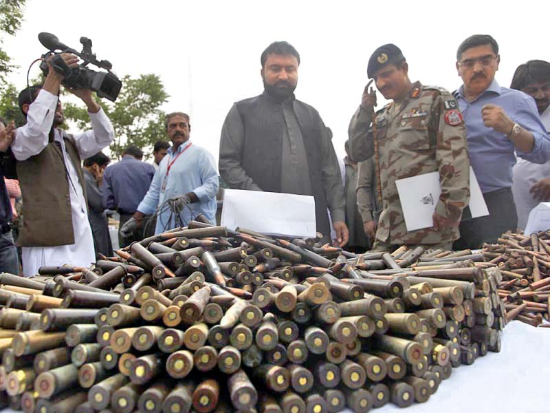Balochistan Home Minister Sarfaraz Bugti reviews the weapons recovered in an operation in Quetta. PHOTO: ONLINE