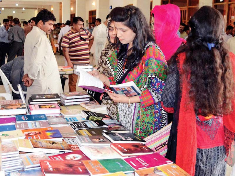 women check out books at a stall set up at the 1st hyderabad literature festival on saturday photo nni