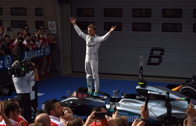 nico rosberg celebrates after winning the formula one chinese grand prix in shanghai on april 17 2016 photo afp