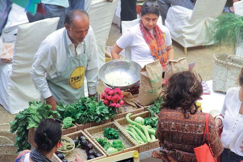 the karachi farmers market set up every sunday morning at haque academy in dha offers fresh vegetables farm eggs varieties of honey plants sherbet bread and milk among other items photo ayesha mir express
