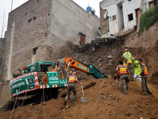 in this file photo rescue officials are seen busy in relief operation after a house collapsed in peshawar on march 24 2016 photo ppi