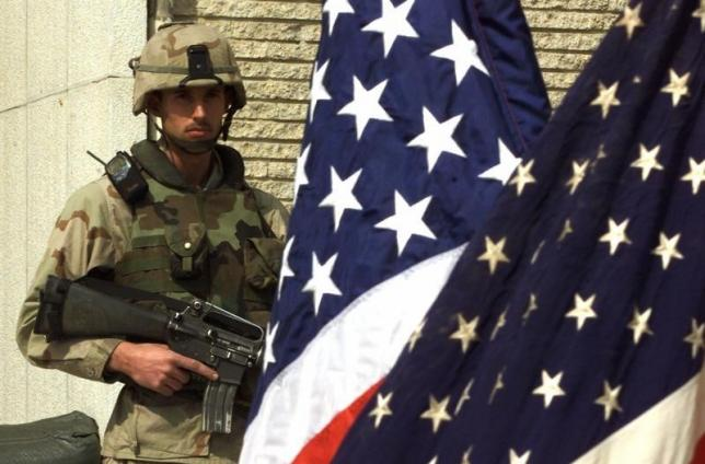 a u s marine soldier stands guard at the u s embassy in kabul february 24 2002 photo reuters