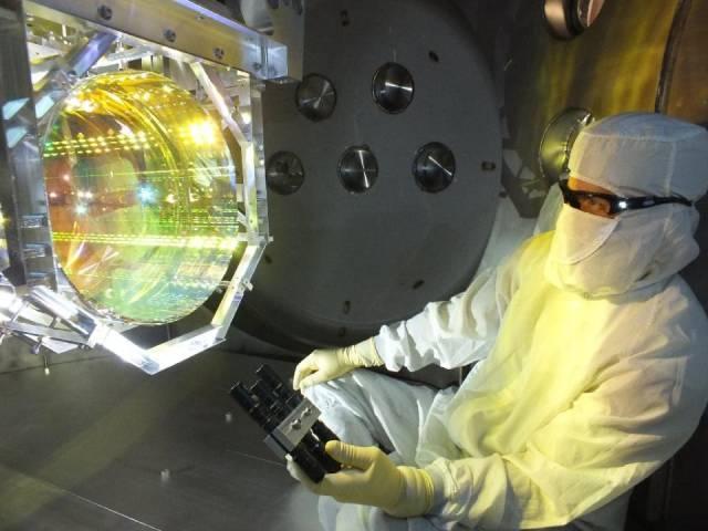 this image taken december 14 2015 shows a laser interferometer gravitational wave observatory ligo optics technician inspecting one of ligo 039 s core optics mirrors photo afp