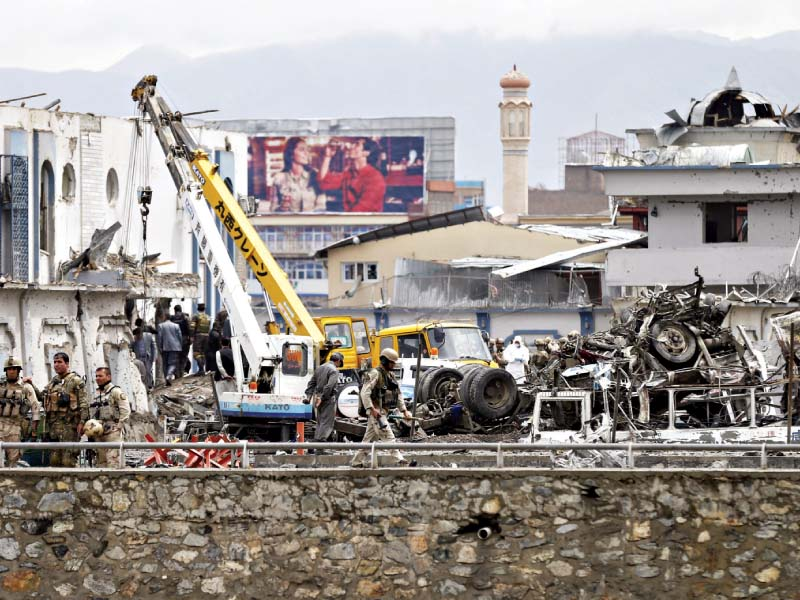 afghan security forces inspect the site of the suicide car bomb attack in kabul photo reuters