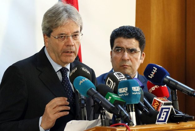 paolo gentiloni says increased partnership would counter illegal migration photo afp