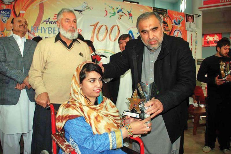 zainab receives an award after she won a competition photo express