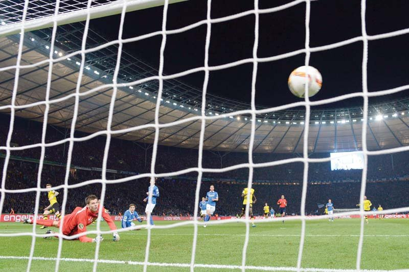hertha s norwegian goalkeeper rune jarstein l looks on as reus s strike nestles into the net to give dortmund a 2 0 lead that settled any remaining nerves photo afp