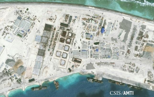The northwest side of Mischief Reef showing a 1,900 foot seawall and newly-constructed infrastructure including housing, an artificial turf parade grounds, cement plants, and docking facilities are shown in this Center for Strategic and International Studies (CSIS) Asia. PHOTO: REUTERS