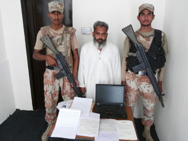muhammad ashfaq was caught red handed with solved copies of matriculation exam papers in karachi say rangers photo sindh rangers