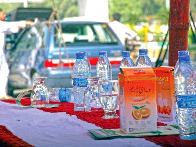 oral rehydration salts and water bottles were offered at the first relief response centre established by the health department and the city administration near nipa on university road on friday photo athar khan express