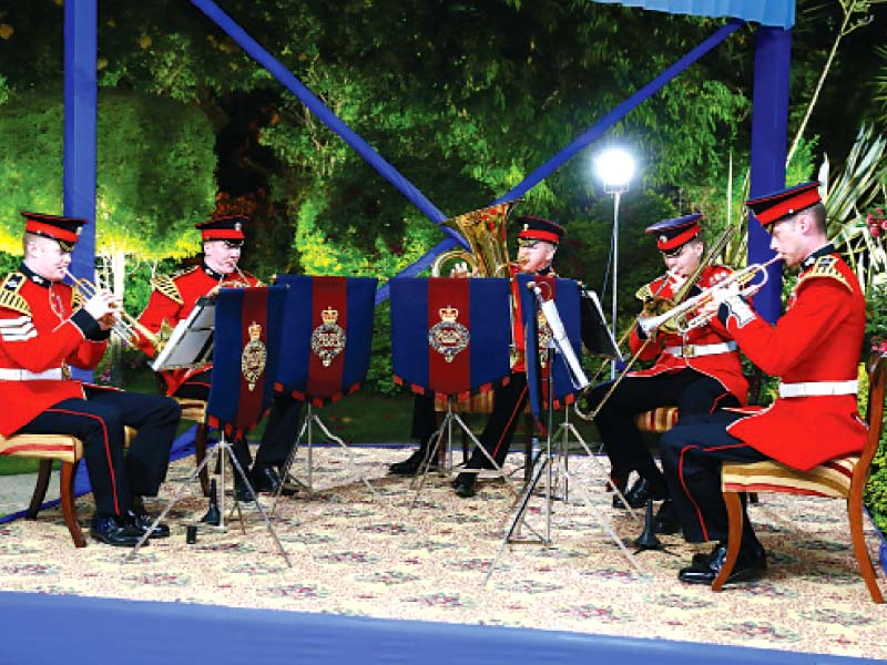 the event featured music from a british military quintet and british cuisine such as the iconic fish and chips wrapped in newspaper photo express