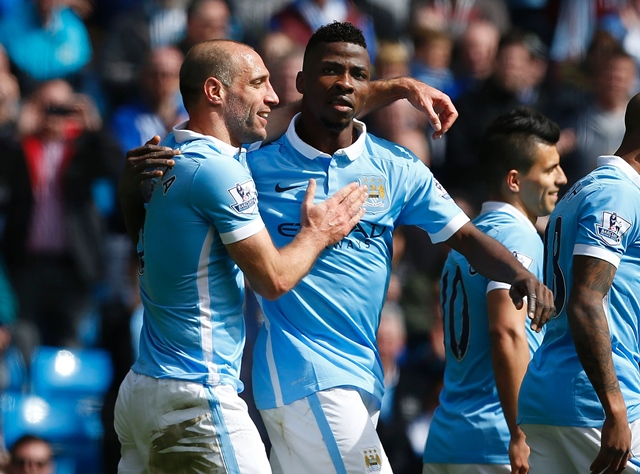 kelechi iheanacho celebrates with pablo zabaleta l after scoring manchester city 039 s third goal against stoke city at the etihad stadium in manchester england on april 23 2016 photo afp