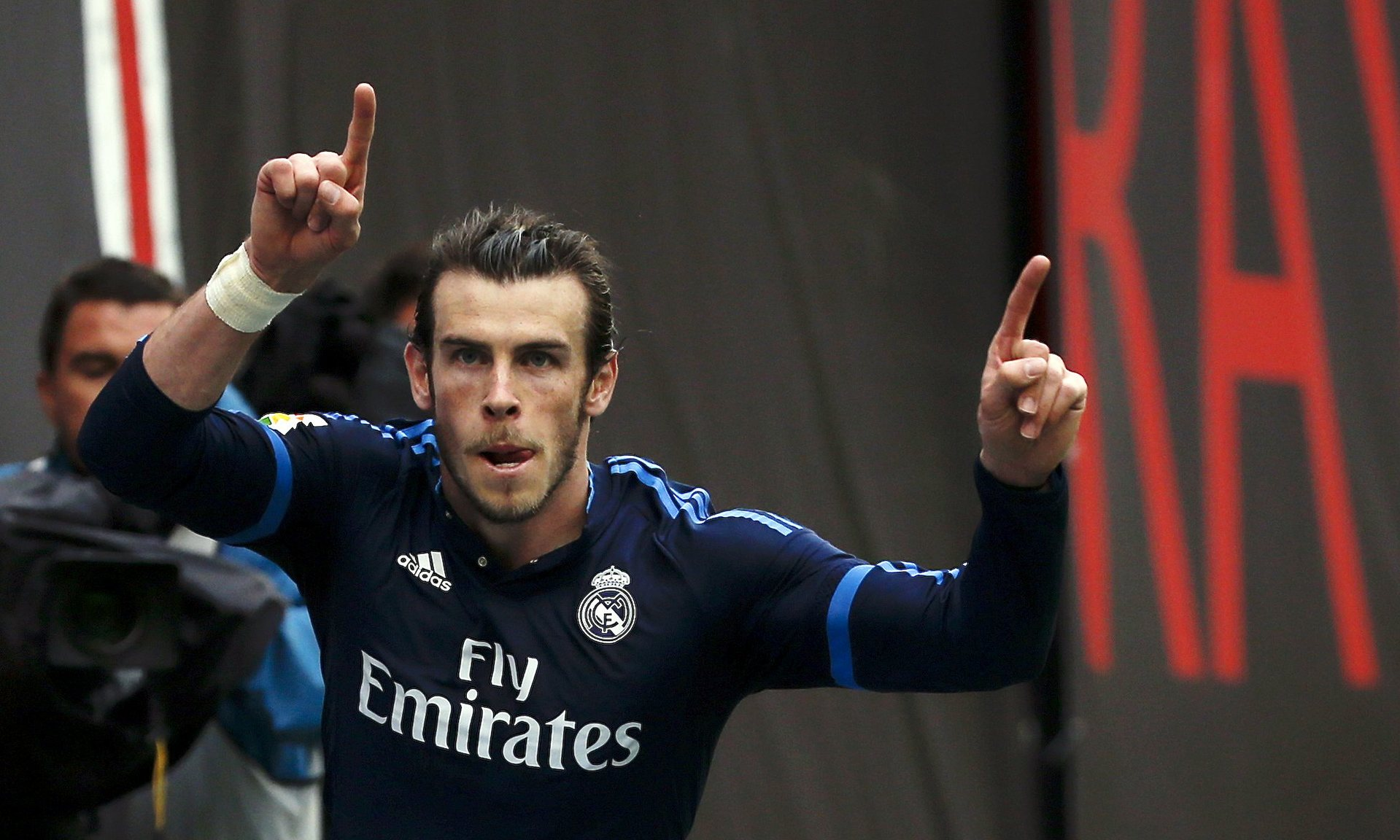 gareth bale celebrates after scoring his first goal in the match against rayo vallecano photo reuters