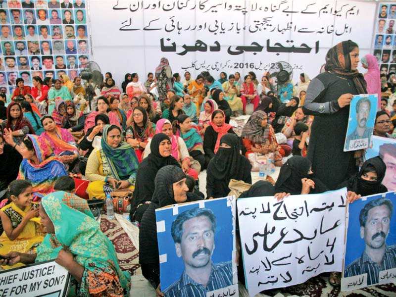 family of missing mqm workers along with senior party leaders held a sit in at the karachi press club in hopes of ascertaining their whereabouts photo athar khan express