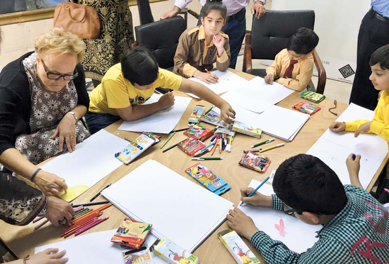 charg d affaires of the embassy of denmark interacts with the participating children photo express