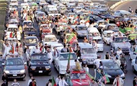 supporters of the pakistan tehreek e insaf drive towards the f 9 park photo waseem nazir express