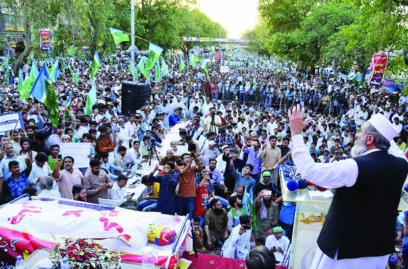 a mock coffin of corruption lies near stage as jamaat e islami ameer sirajul haq addresses the anti graft gathering in lahore photo online