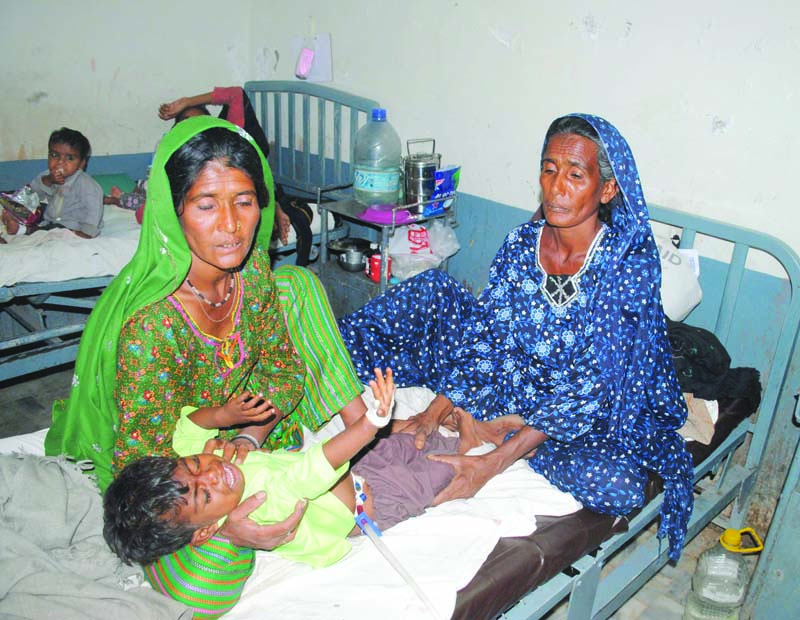 women tend a child suffering from malnutrition at mithi hospital in tharparkar photo file