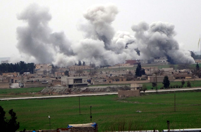 a picture taken on february 27 2016 in akcakale in sanliurfa province shows smoke rising from the neighbourhood of syrian city tel abyad during clashes between islamic state group and people 039 s protection units ypg photo afp