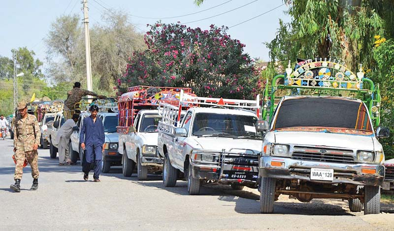 election officials in dhahdhar town load polling material on vehicles headed for various polling stations for by elections in jhal magsi constituency of na 267 pti balochistan organiser yar mohammad rind will face pml n candidate khalid magsi for the seat photo online