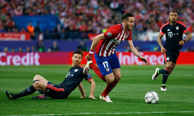 saul niguez skips past the challenge of xabi alonso as he starts his mazy jinky run into the area to score photo reuters