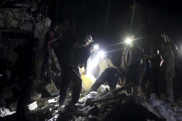 civil defence members search for survivors after an airstrike at a field hospital in the rebel held area of al sukari district of aleppo syria april 27 2016 photo reuters