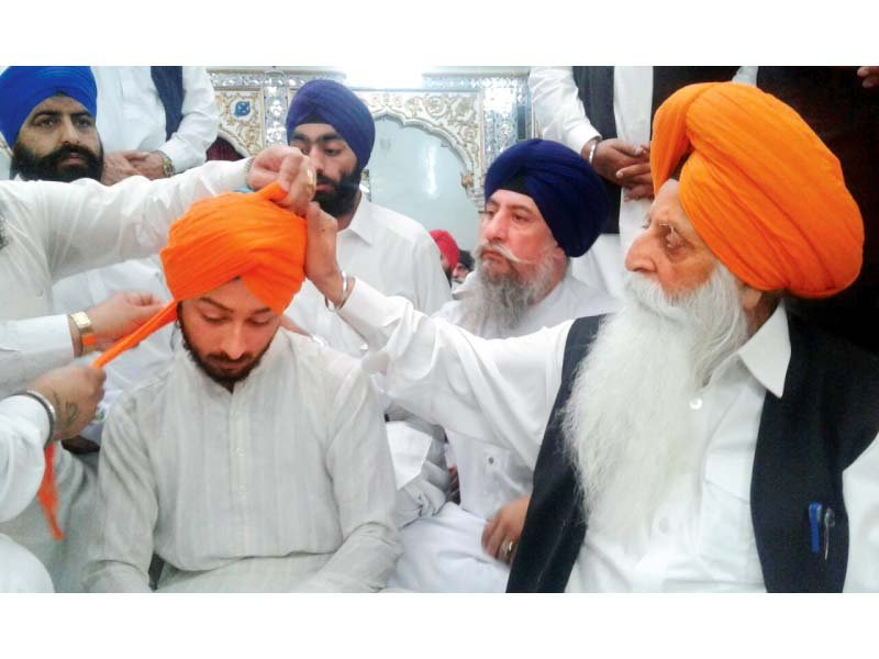 ajay singh s dastar bandi during a condolence reference at gurdwara bhai joga singh photo jehangir shahzad express