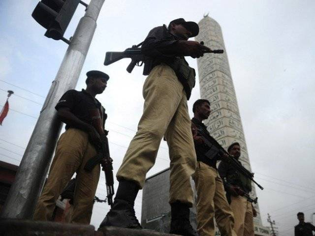 the exchange of fire took place in pirabad area of karachi also injuring a passer by photo reuters file