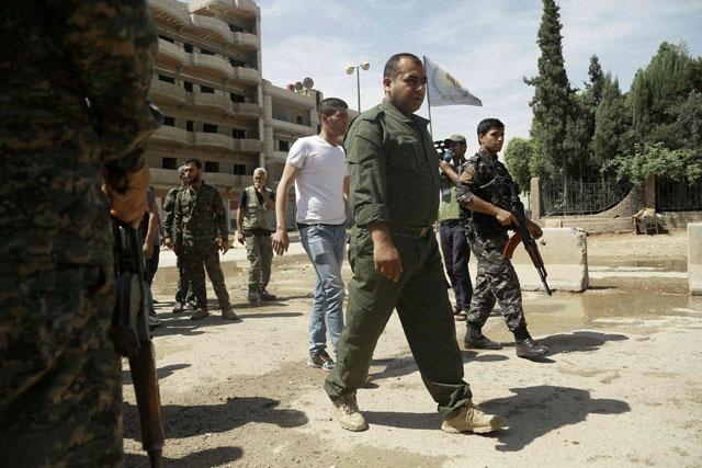 jowan ibrahim c the commander of the kurdish police known as the asayish arrives at a checkpoint where a suicide bomber killed five kurdish policemen on april 30 2016 in syria 039 s divided northeastern city of qamishli photo afp