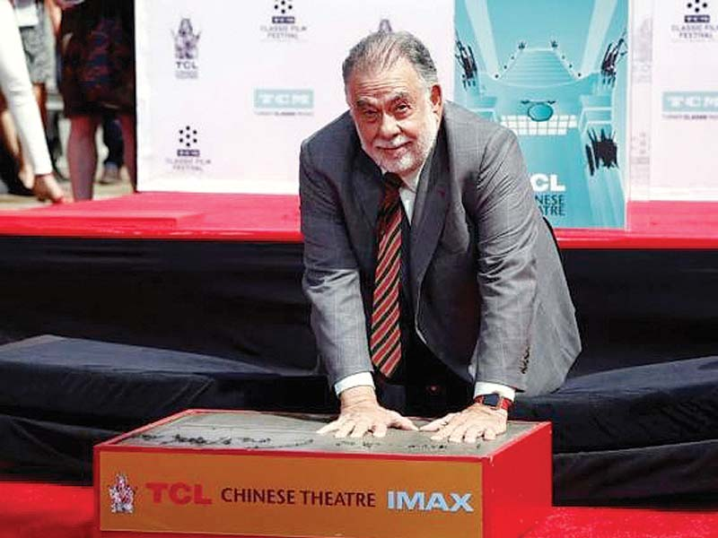 director francis ford coppola places his handprints in cement during a ceremony in the forecourt of the tcl chinese theatre in hollywood photo reuters