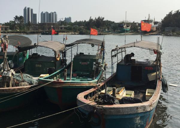 fishing boats with chinese national flags are seen at a harbour in tanmen hainan province april 5 2016 photo reuters