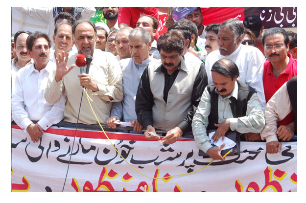 Former federal minister Qamar Zaman Kaira addressing a rally organised by the Pakistan Peoples Party (PPP) to mark the International Labour Day. PHOTO: EXPRESS
