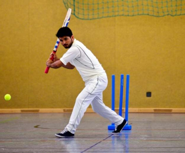 an afghan refugee takes part in a cricket training session at the team of the altendorf 09 blue tigers in essen western germany on april 30 2016 photo afp