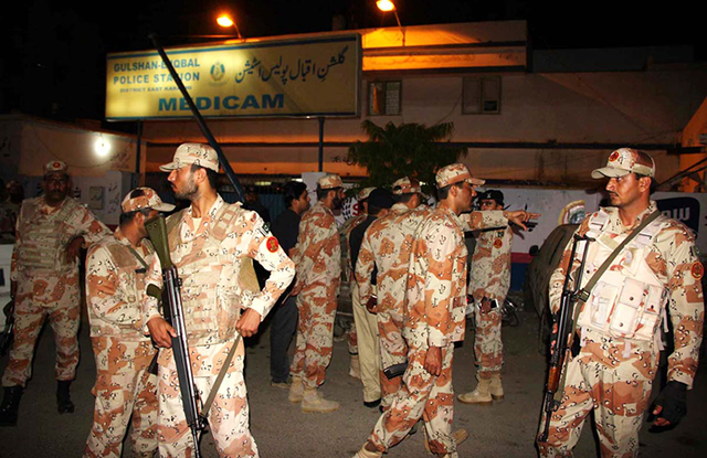 Rangers personnel standing on alert during a raid in a Karachi area. PHOTO: ONLINE