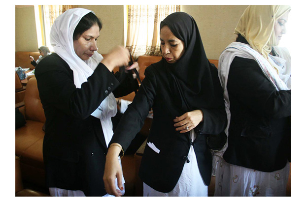 women lawyers tie black ribbons on arms during boycott of court proceedings to mark the anniversary of may 12 incident photo online