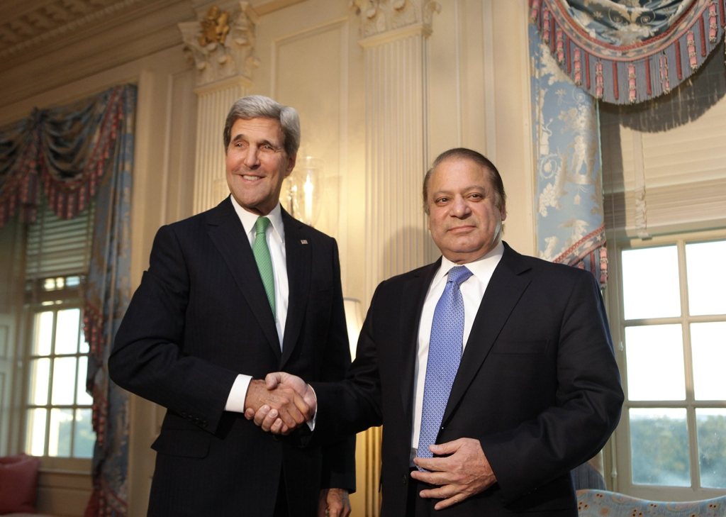 US Secretary of State John Kerry (L) shakes hands with Prime Minister Nawaz Sharif before their meeting at the State Department in Washington October 20, 2013. PHOTO: REUTERS
