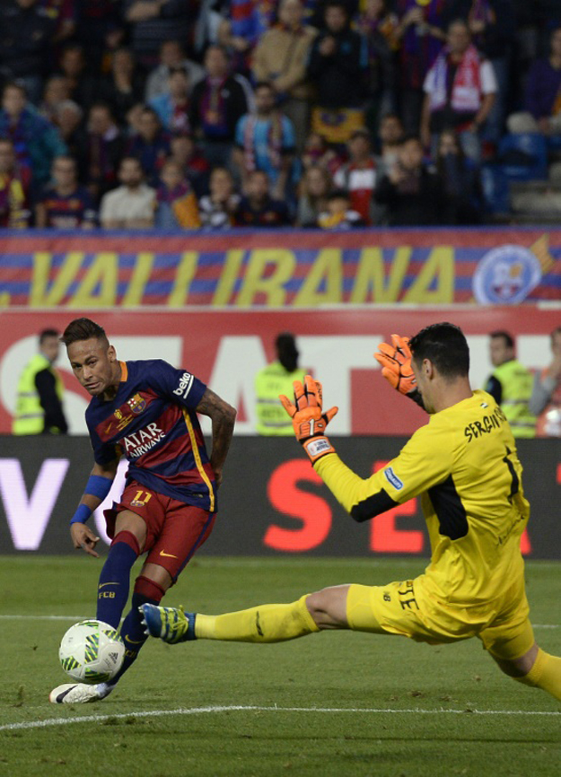 barcelona edge out sevilla in bad tempered cup final
