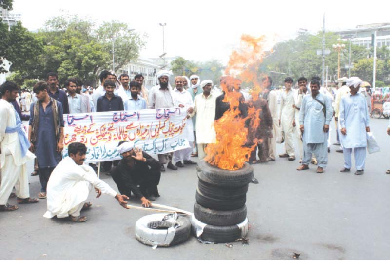 pki activists set fire to tyres on the mall photo abid nawaz express